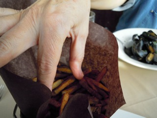 Hungry fingers reaching for the frites.jpg