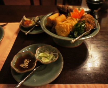 Baan Kanitha - Apps - Marinated grilled chicken, shrimp cakes, fish cakes, spring rolls with dips.JPG