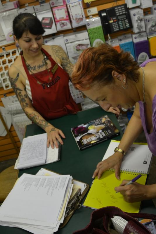 Katie Loeb signs her new book.jpg