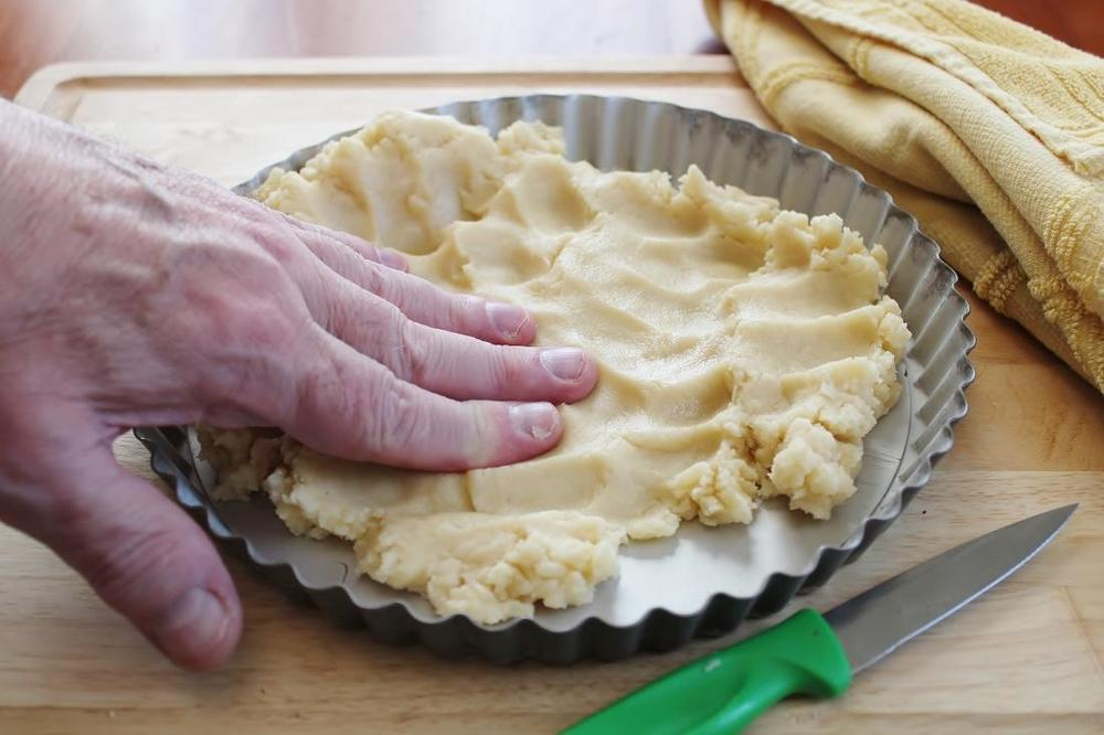 Forming Shortbread in Tart Pan.JPG